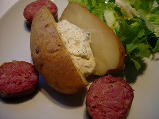 Baked potoatoes with herb butter or cream