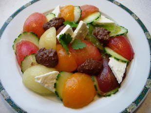 Multicoloured cucumber-tomato salad