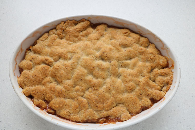 Autumn apple and plum crumble pie