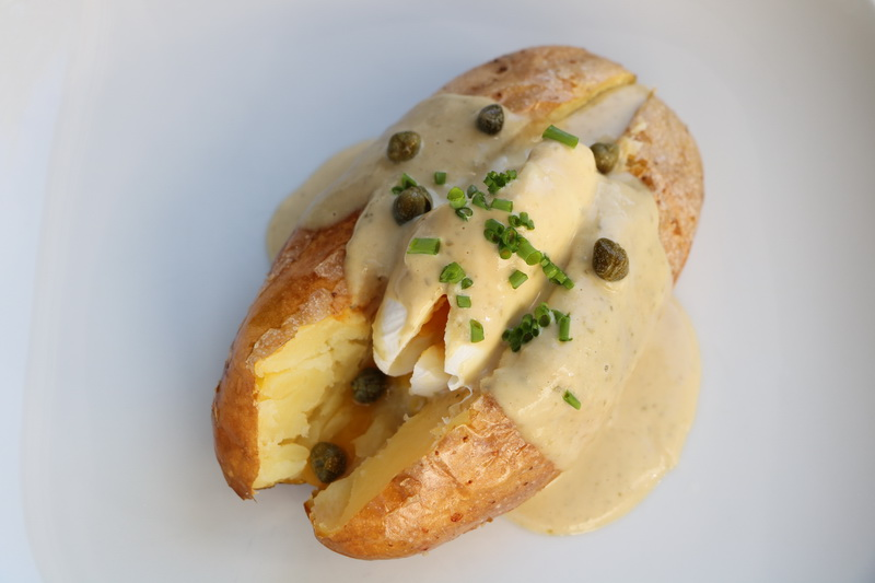 Baked potatoes with poached egg and tuna sauce
