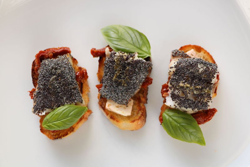 Canapés of red mullet with poppy seeds