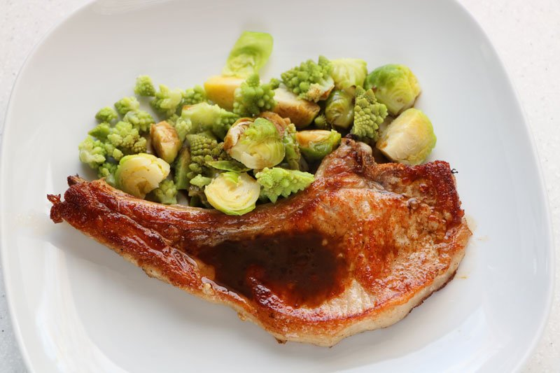 Pork chops with a duo of brassicas
