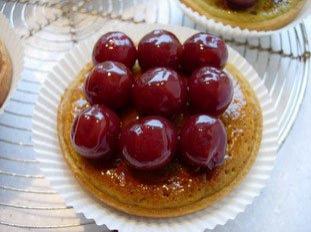 Cherry and pistachio tarts